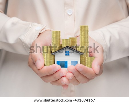 ownership concept with hand holding 3d rendering house model - stock photo