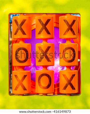 OX puzzle game on playground structure for children. It is an outdoor playpark in public park. - stock photo