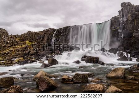 Oxararfoss waterfall in Thingvellir National park in Iceland. This is one of the attractions of the Golden Circle tour near Reykjavik. - stock photo