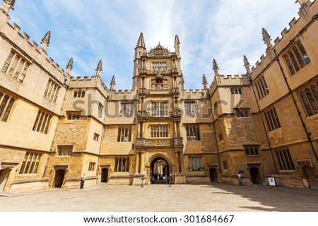 OXFORD, ENGLAND - JULY 03, 2015: Bodleian Library with unidentified people. Its one of the oldest libraries in Europe with over 11 million items and also a film location for Harry Potter and others - stock photo