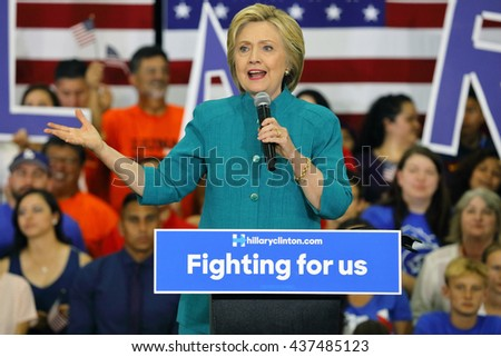 "OXNARD, CA - JUNE 04, 2016: former Secretary of State Hillary Clinton and Democratic Presidential Candidate speaks at a ""Get out the vote"" rally at Hueneme High School in Oxnard, California. - stock photo"