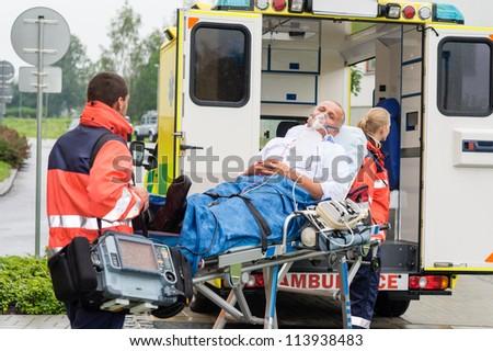 Oxygen mask male patient ambulance stretcher emergency transport hospital - stock photo