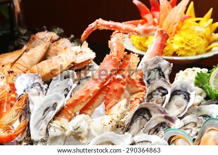 Oyster and Alaska King Crab, Seafood buffet line in hotel restaurant  - stock photo