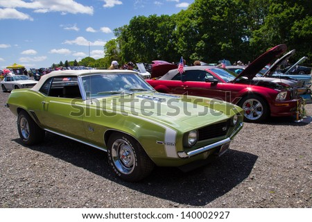 OYSTER BAY, NY - MAY 26:  Classic Camaro on display at New York AutoFest in Oyster Bay, NY on May 26, 2013.  These car shows  help raise funds for charitable organizations. - stock photo