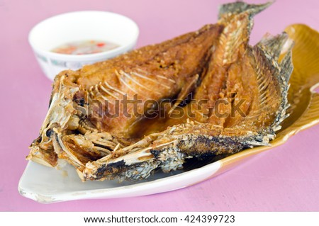 Oyster sauce over fried striped bass fish (famous thai food) - stock photo