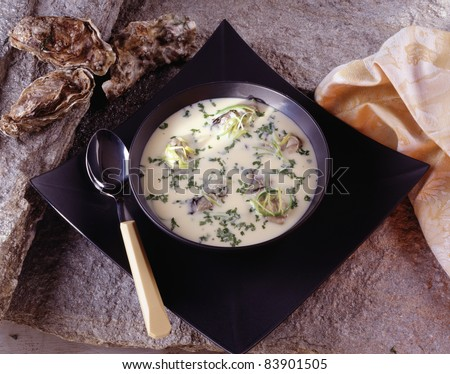 Oyster soup with chervil - stock photo