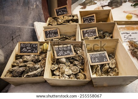Oysters for sale at the seafood market in France - stock photo