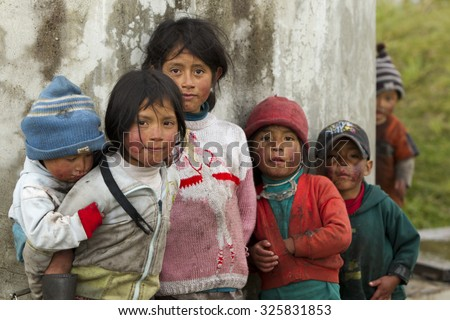 Ozogoche, Ecuador - 19 December 2011: Group Of Dirty And Poorly Dressed Kids Due To The Lack Of Education And Basic Hygiene Services Living In A Rural Area In Ozogoche On December 19, 2011 - stock photo
