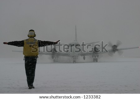 P-3 Orion Taxiing in Snow - stock photo