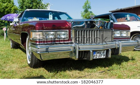 """PAAREN IM GLIEN, GERMANY - MAY 19: Full-size luxury car Cadillac Coupe de Ville, """"The oldtimer show"""" in MAFZ, May 19, 2013 in Paaren im Glien, Germany  - stock photo"""