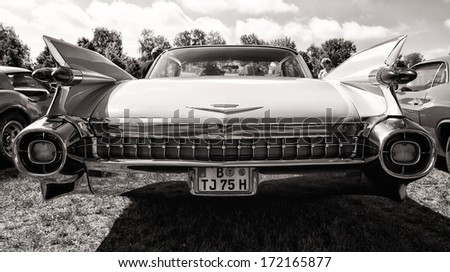 PAAREN IM GLIEN, GERMANY - MAY 19: Full-size luxury car Cadillac Sixty Special Fleetwood, rear view, black and white, The oldtimer show in MAFZ, May 19, 2013 in Paaren im Glien, Germany  - stock photo