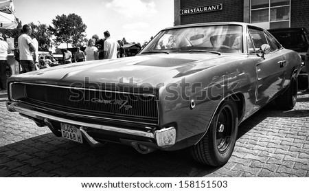 "PAAREN IM GLIEN, GERMANY - MAY 19: Mid-size car Dodge Charger R/T, (black and white), ""The oldtimer show"" in MAFZ, May 19, 2013 in Paaren im Glien, Germany - stock photo"