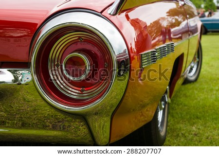 PAAREN IM GLIEN, GERMANY - MAY 23, 2015: Stoplight of a personal luxury car Ford Thunderbird (third generation). The oldtimer show in MAFZ. - stock photo