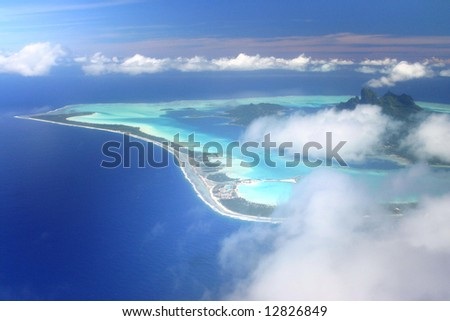 Pacific Island Bora Bora hidden by the clouds. Aerial view. French Polynesia - stock photo