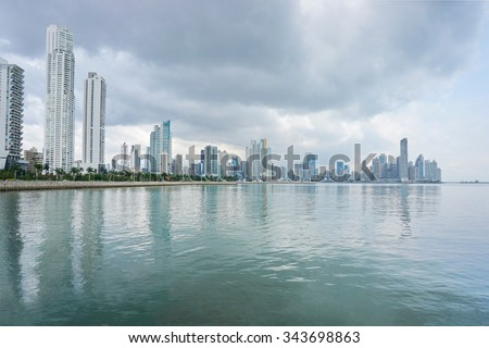 Pacific ocean coastline with Panama City skyscrapers and cloudy sky, Panama, Central America - stock photo