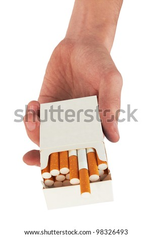 Pack of cigarettes in hand, isolated on white background - stock photo