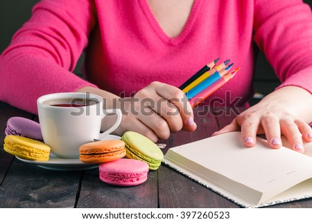 Pack of colorful pencils in woman hands - stock photo