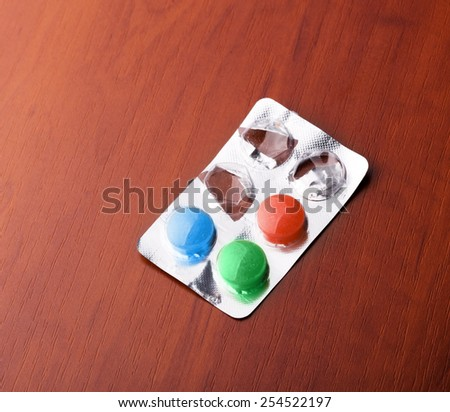 Pack with pills on the table - stock photo