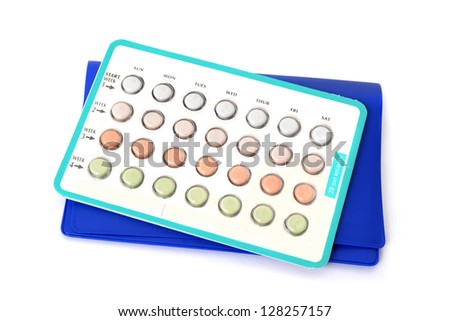 package of birth control pills white background - stock photo