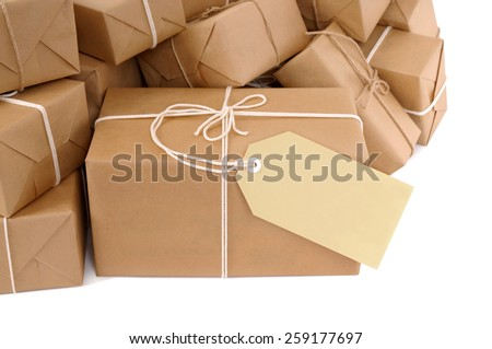 Package : Untidy pile of brown parcel, label - stock photo