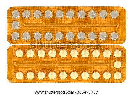 Packaged of Birth Control Pills and one with condoms inside, isolated on white - stock photo