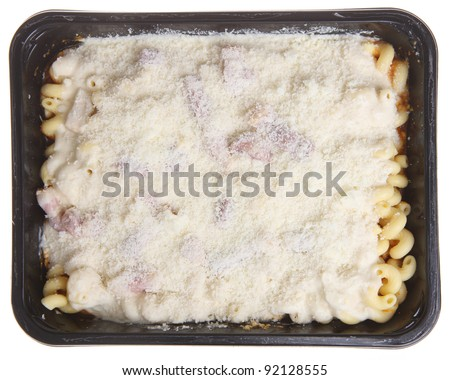 Packaged pasta meal with chicken bacon and cheese. Uncooked. - stock photo