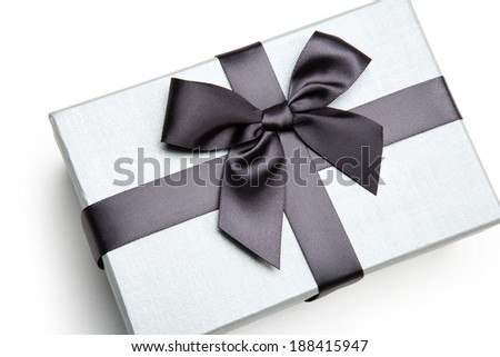 Packaging gift box / studio photography of black and white box wrapping ribbon with bowknot - on white background  - stock photo
