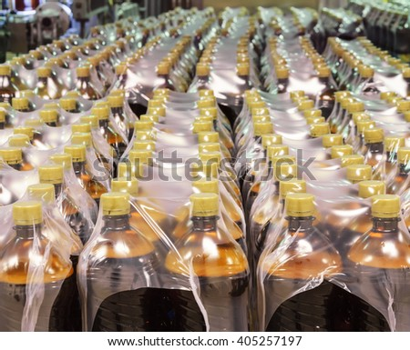 Packaging plastic bottles at the brewery - stock photo