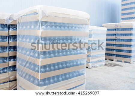 packed boxes with wine bottles at yard - stock photo