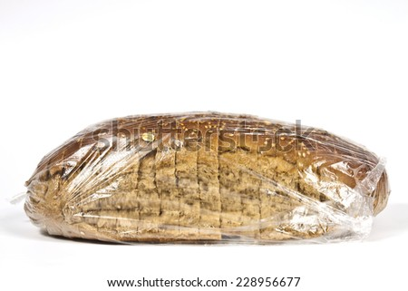 Packed in plastic bag hand-made rye bread diet - stock photo