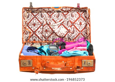 Packed leather suitcase fdr a beach vacation - stock photo