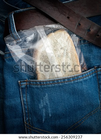 Packed moldy slice of bread in the pocket. - stock photo