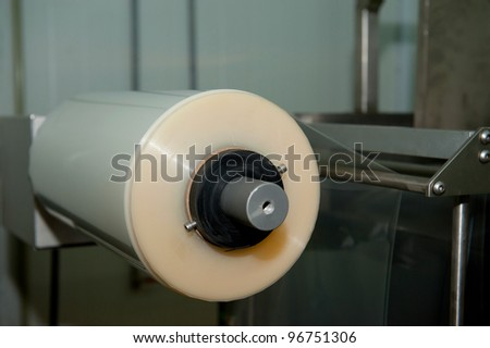 packing tape on the machine - stock photo