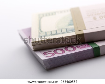 Packs of dollars and euros - stock photo