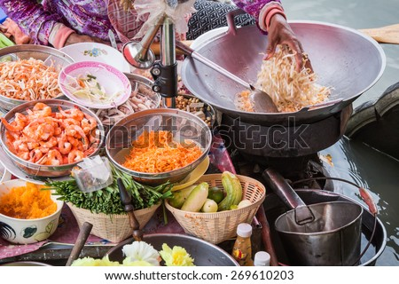Pad Thai cooking on the boat in Amphawa floating market - stock photo