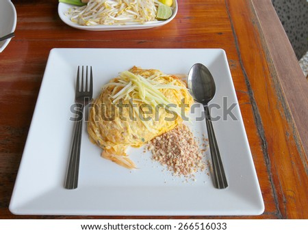 Pad Thai Goong Sod, thin rice noodles fried with tofu Thailand's national dishes, stir-fried noodles with egg, - stock photo