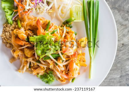 Pad thai noodles in white plate - thai food - stock photo