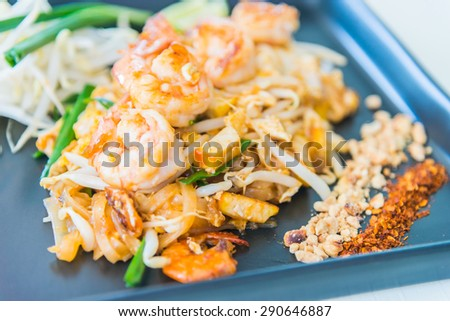 Pad thai , Thai noodles style with shrimp and vegetable - selective focus point - stock photo