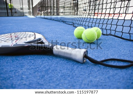 Paddle objects on blue turf - stock photo