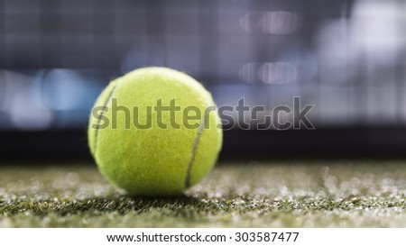 Paddle tennis balls in court with night ambient light and narrow deep of field. - stock photo