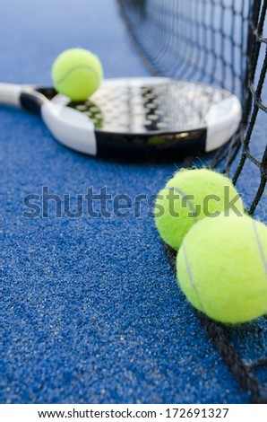 paddle tennis objects on artificial turf ready for tournament, focus in second ball - stock photo