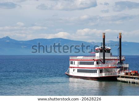 Paddle wheel boat docked on a lake - stock photo