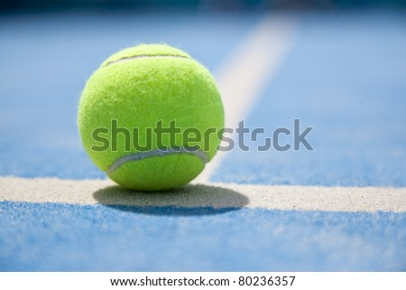 Padel and tennis ball on a court - stock photo
