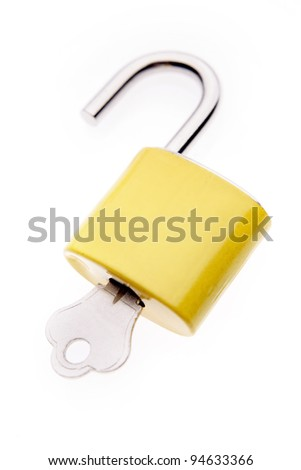 Padlock and key on plain background - stock photo