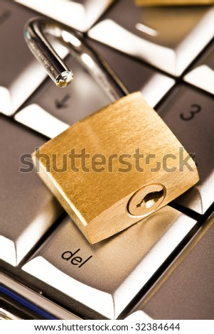 Padlock and notebook computer - stock photo