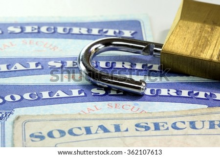 Padlock and social security card - Identity theft and identity protection concept - stock photo