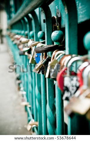 Padlock hanging on one of the bridges in Wroclaw - stock photo