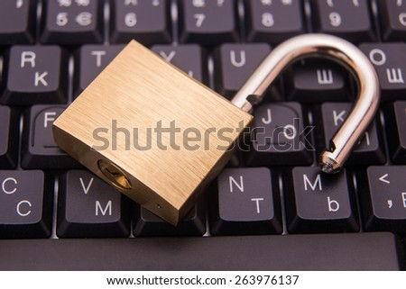 Padlock on a laptop keyboard. Concept of internet security - stock photo