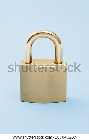 Padlock on blue background. - stock photo