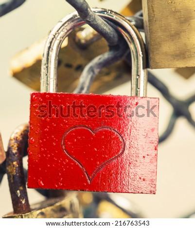 padlock on bridge in paris - stock photo